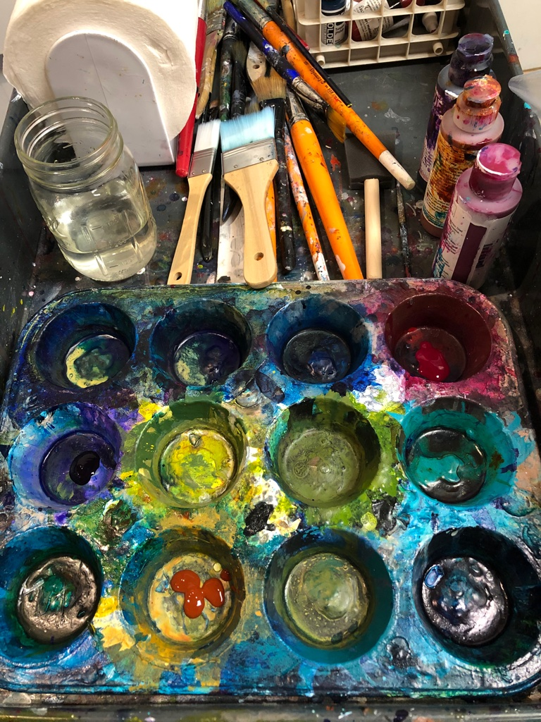Paint brushes, paint palette and bottles of paint from Melynda Van Zee Studio